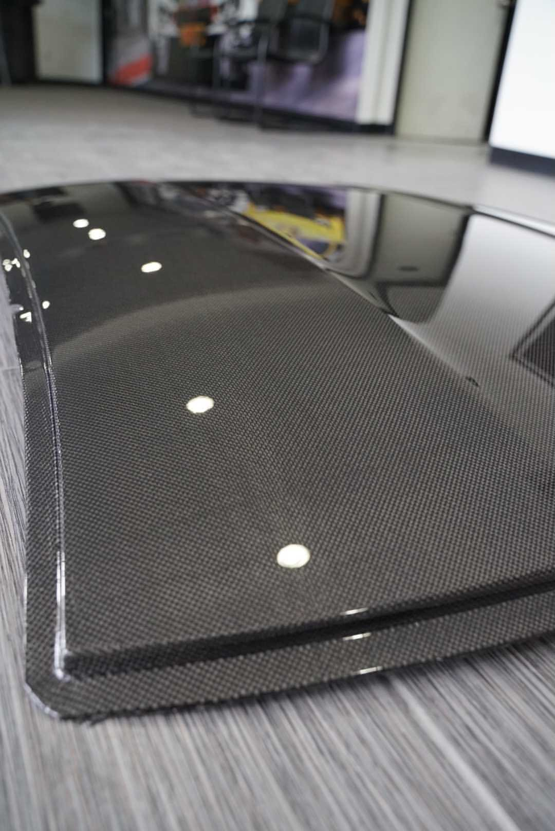 Vacuum bagged for strength and weight, the 2M Autowerks BMW F82 M4 Carbon Fiber Roof is a great performance modification that looks great!
