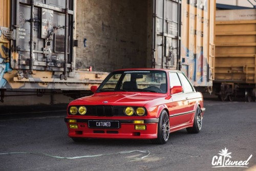 In collaboration with CA, we built a super clean Henna Red BMW E30.